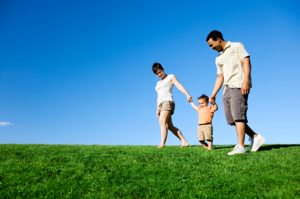 Family Walking on Grass