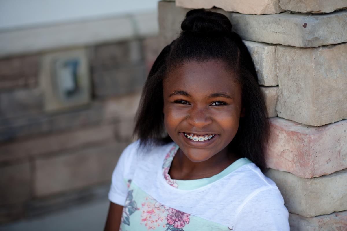 young African american girl head-shot, smiling