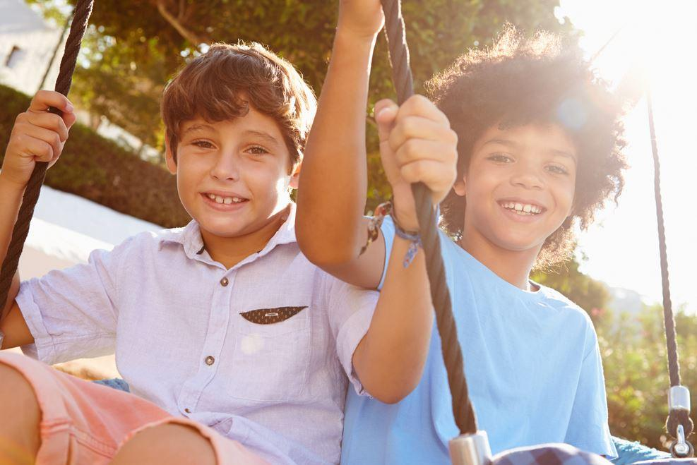 Two teen boys on swing