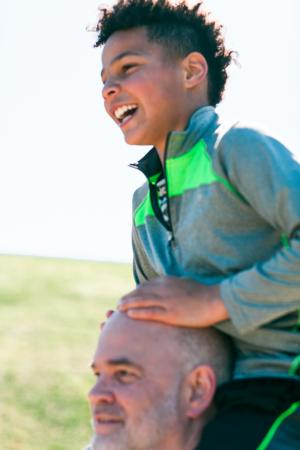 Teen on male shoulders